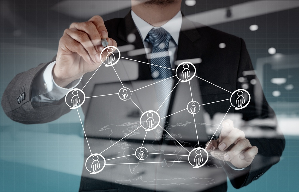 Double exposure of businessman working with new modern computer show social network structure.jpeg