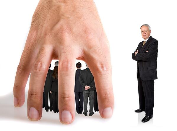 business team underneath a hand over a white background while their boss in next to them