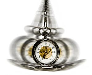 clock in motion over white - hypnotism concept
